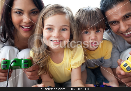 Close-up of family playing video game  stock photo, Close-up of family playing video game  in the living room by Wavebreak Media