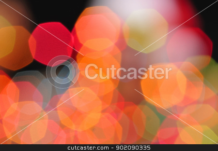 Blurred colors stock photo, Colorful blurred Christmas lights in orange, red, blue and green form heptagon shapes by Chad Zuber