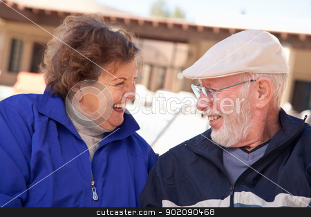 Happy Senior Adult Couple Bundled Up Outdoors stock photo, Happy Senior Adult Couple Portrait Bundled Up Outdoors. by Andy Dean