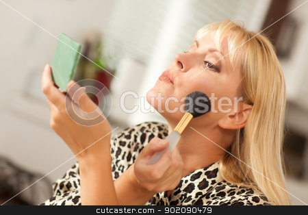 Blonde Woman Applying Her Makeup stock photo, Attractive Blonde Woman Applying Her Makeup Indoors. by Andy Dean