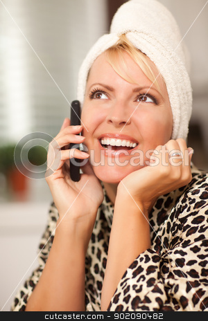 Attractive Caucasian Woman Talking on Cell Phone stock photo, Attractive Smiling Caucasian Woman Talking on Her Cell Phone with a Towel on Her Head. by Andy Dean