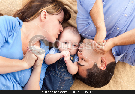 Mixed Race Family with Baby Playing on the Blanket stock photo, Mixed Race Family with Baby Playing Face Up on the Blanket by Andy Dean
