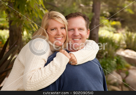 Happy Attractive Caucasian Couple in the Park stock photo, Happy Attractive Adult Caucasian Couple Portrait in the Park. by Andy Dean