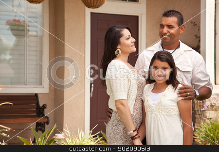 Small Happy Hispanic Family in Front of Their Home stock photo, Happy Hispanic Mother, Father and Daughter in Front of Their Home. by Andy Dean