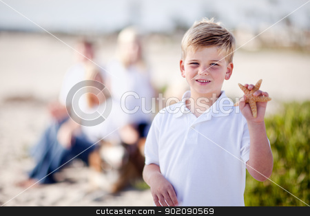 Cute Little Blonde Boy Showing Off His Starfish stock photo, Cute Little Blonde Boy Showing Off His Starfish at the Beach. by Andy Dean