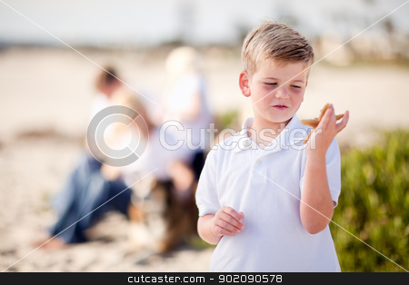 Cute Little Blonde Boy Holding His Starfish stock photo, Cute Little Blonde Boy Holding His Starfish at the Beach. by Andy Dean
