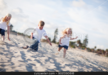 Adorable Brother and Sisters Having Fun at the Beach stock photo, Adorable Brother and Sisters Having Fun at the Beach one Afternoon. by Andy Dean