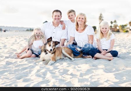 Happy Caucasian Family Portrait at the Beach stock photo, Happy Caucasian Family and Their Dog Portrait at the Beach. by Andy Dean
