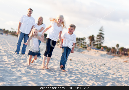 Adorable Caucasian Family on a Walk stock photo, Adorable Caucasian Family on a Walk at the Beach. by Andy Dean