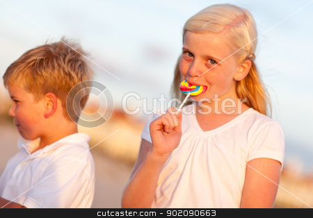 Cute Little Girl and Brother Enjoying Their Lollipops stock photo, Cute Little Girl and Brother Enjoying Their Lollipops One Afternoon. by Andy Dean
