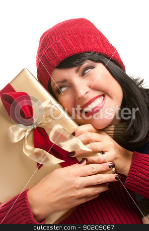 Happy Attractive Woman Holding Holiday Gift stock photo, Happy Attractive Woman Holding a Holiday Gift Isolated on a White Background. by Andy Dean