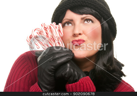 Pretty Young Woman Holding Candy Canes stock photo, Pretty Young Woman Holding Candy Canes Isolated on a White Background. by Andy Dean