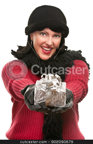 Pretty Young Woman Offering Holiday Gift stock photo, Pretty Young Woman Offering Holiday Gift Isolated on a White Background. by Andy Dean