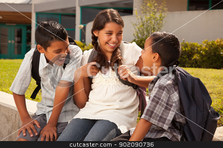 Hispanic Brothers and Sister Talking Ready for School stock photo, Cute Hispanic Brothers and Sister Talking Ready for School on Morning. by Andy Dean