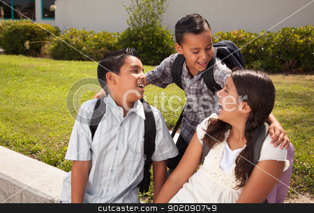 Cute Brothers and Sister Talking, Ready for School stock photo, Cute Brothers and Sister Talking, Wearing Backpacks Ready for School. by Andy Dean