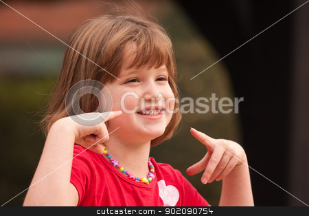 Adorable Girl Poses While Playing stock photo, Adorable Girl Poses While Playing Outside. by Andy Dean
