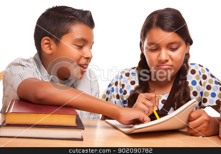 Hispanic Brother and Sister Having Fun Studying stock photo, Hispanic Brother and Sister Having Fun Studying Together Isolated on a White Background. by Andy Dean