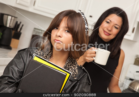 Pretty Hispanic Girl Ready for School with Mom stock photo, Pretty Hispanic Girl and Mother Getting Ready for School in the Kitchen. by Andy Dean