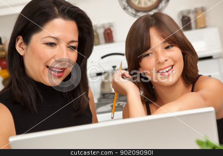 Hispanic Mother and Mixed Race Daughter on the Laptop stock photo, Attractive Hispanic Mother and Mixed Race Daughter in the Kitchen using the Laptop Computer Together. by Andy Dean