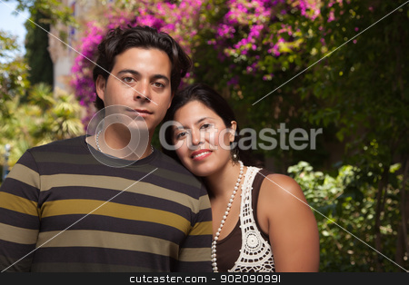 Happy Attractive Hispanic Couple At The Park stock photo, Happy Attractive Hispanic Couple Enjoying Themselves At The Park. by Andy Dean