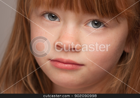 Fun Portrait of an Adorable Red Haired Girl on Grey stock photo, Fun Portrait of an Adorable Red Haired Girl on a Grey Background. by Andy Dean
