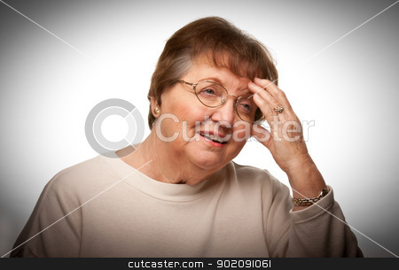 Senior Woman with Aching Head stock photo, Senior Woman with Aching Head With a Dramatic Vignetted Background. by Andy Dean