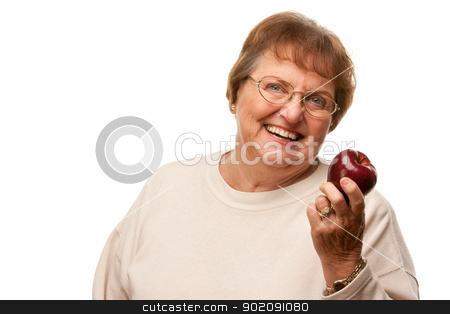 Attractive Senior Woman with Red Apple stock photo, Attractive Senior Woman with Red Apple Isolated on a White Background. by Andy Dean