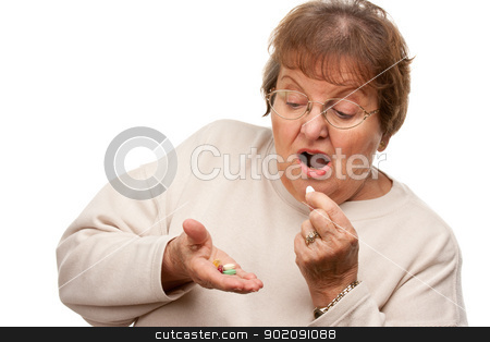 Attractive Senior Woman and Medication Pills stock photo, Attractive Senior Woman and Medication Pills Isolated on a White Background. by Andy Dean