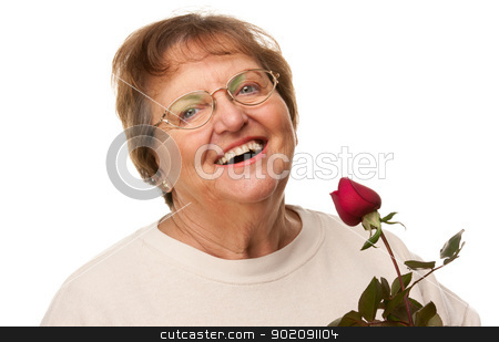Attractive Senior Woman with Red Rose stock photo, Attractive Senior Woman with Red Rose Isolated on a White Background. by Andy Dean