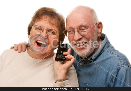 Happy Senior Couple Using Cell Phone on White stock photo, Happy Senior Couple Using Cell Phone Isolated on a White Background. by Andy Dean