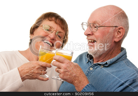 Happy Senior Couple with Glasses of Orange Juice stock photo, Happy Senior Couple with Glasses of Orange Juice Isolated on a White Background. by Andy Dean