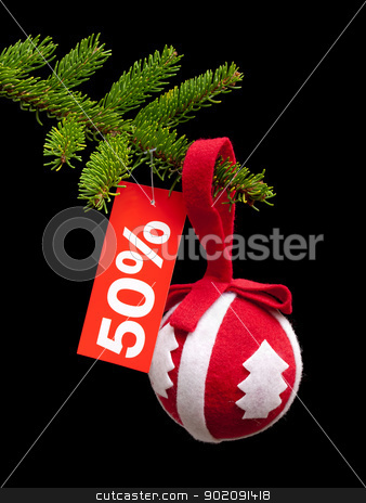 Christmas discount stock photo, Retro Christmas ball is hanging on a fir tree branch with a discount label. by Sinisa Botas