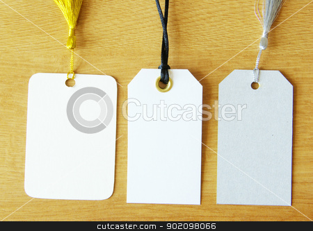blank tag  stock photo, Blank tag isolated on a wooden background by Vitaliy Pakhnyushchyy