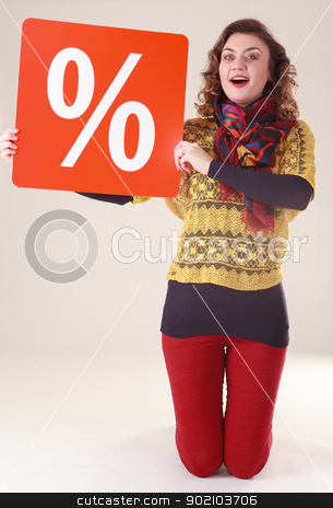 Woman with percentage sign stock photo, Young attractive woman with red percent sign for the final sale by Roland Stollner