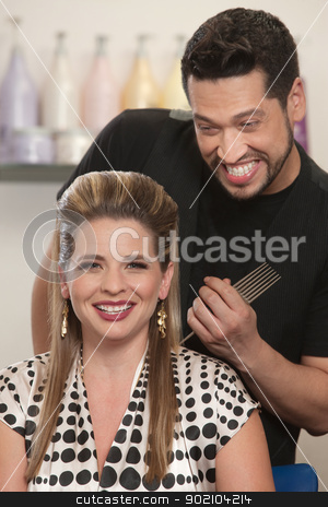 Happy Hair Stylist and Customer stock photo, Pretty Caucasian woman and bearded hair stylist smiling by Scott Griessel