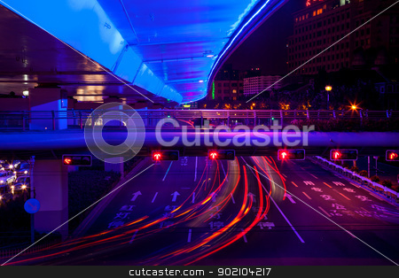 Blue Highway Street Traffic Red Night Light Trails Central Shang stock photo, Blue Highway Street Traffic Cars and Light Trails at Night in Central Shanghai, China.  by William Perry