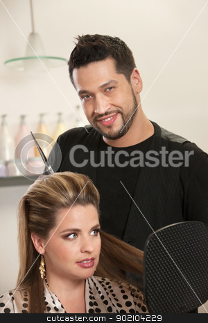 Handsome Male Hairdresser with Client stock photo, Attractive male Hispanic hairdresser with smiling customer by Scott Griessel