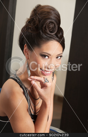 Smiling Woman with Retro Hairdo stock photo, Pretty young woman with curls in retro hairdo by Scott Griessel