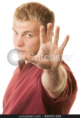 Handsome Blond Man with Hand Out stock photo, Blond man holding hand up in front of face by Scott Griessel
