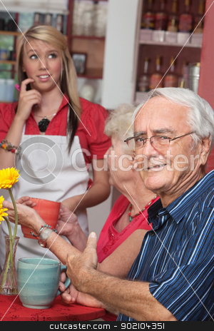 Man Annoyed with Waitress stock photo, Annoyed man with unskilled server in cafe by Scott Griessel
