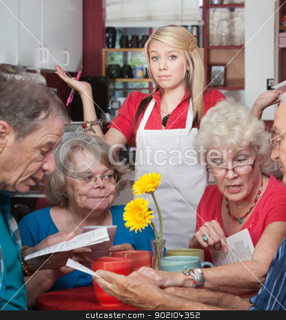 Waitress With Slow Customers stock photo, Frustrated waitress with customers trying to read the menu by Scott Griessel