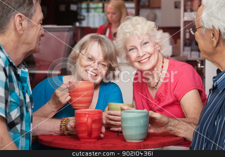 Smiling Senior Ladies stock photo, Senior female friends smiling at cafe with group by Scott Griessel