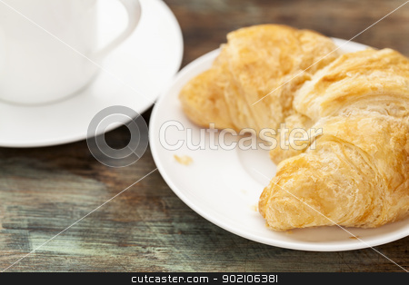 croissant roll and coffee stock photo, croissant roll with espresso coffee cup on grunge painted wooden table, shallow depth of field by Marek Uliasz
