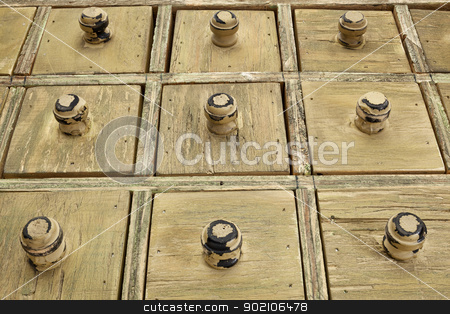 rustic drawer cabinet stock photo, primitive wooden apothecary or catalog drawer cabinet, low view angle by Marek Uliasz