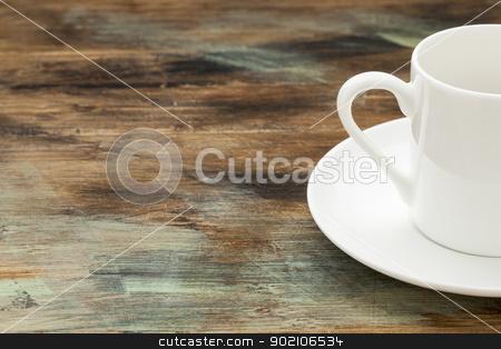 coffee cup on wooden table stock photo, white china espresso coffee cup on wooden grunge table by Marek Uliasz
