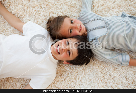 Brother and sister lying on the floor  stock photo, Brother and sister lying on the floor with heads together by Wavebreak Media