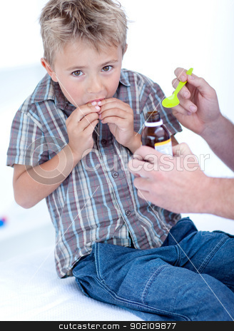 Cold child taking syrup stock photo, Cold child taking syrup because of the flu by Wavebreak Media