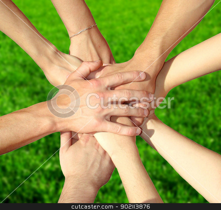 hands  stock photo, hands of my friends on green grass by Vitaliy Pakhnyushchyy