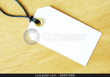 paper tag  stock photo, paper tag isolated on a wooden background by Vitaliy Pakhnyushchyy