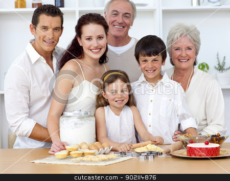 Big family baking in the kitchen stock photo, Portrait of happy big family baking in the kitchen by Wavebreak Media